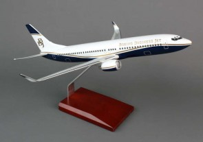Executive Series Display Model Boeing Business Jet New Livery B737-700  Crafted from resin and comes with a wooden base.  Item: H10510