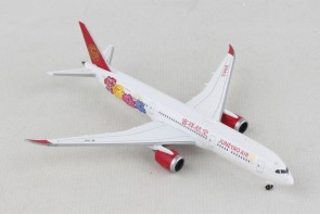 Juneyao Boeing 787-9 Flowers 1st Delivery B-1115 Herpa Wings 533089 scale 1:500